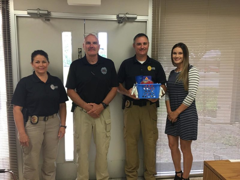 Port Neches PD poses with our marketing team for National Police Week.