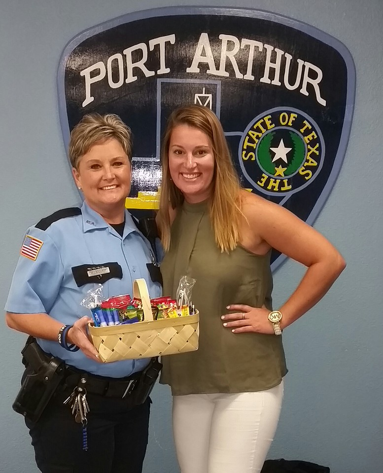 Director of Marketing, Kari, with a Port Arthur officer, delivering goodies.